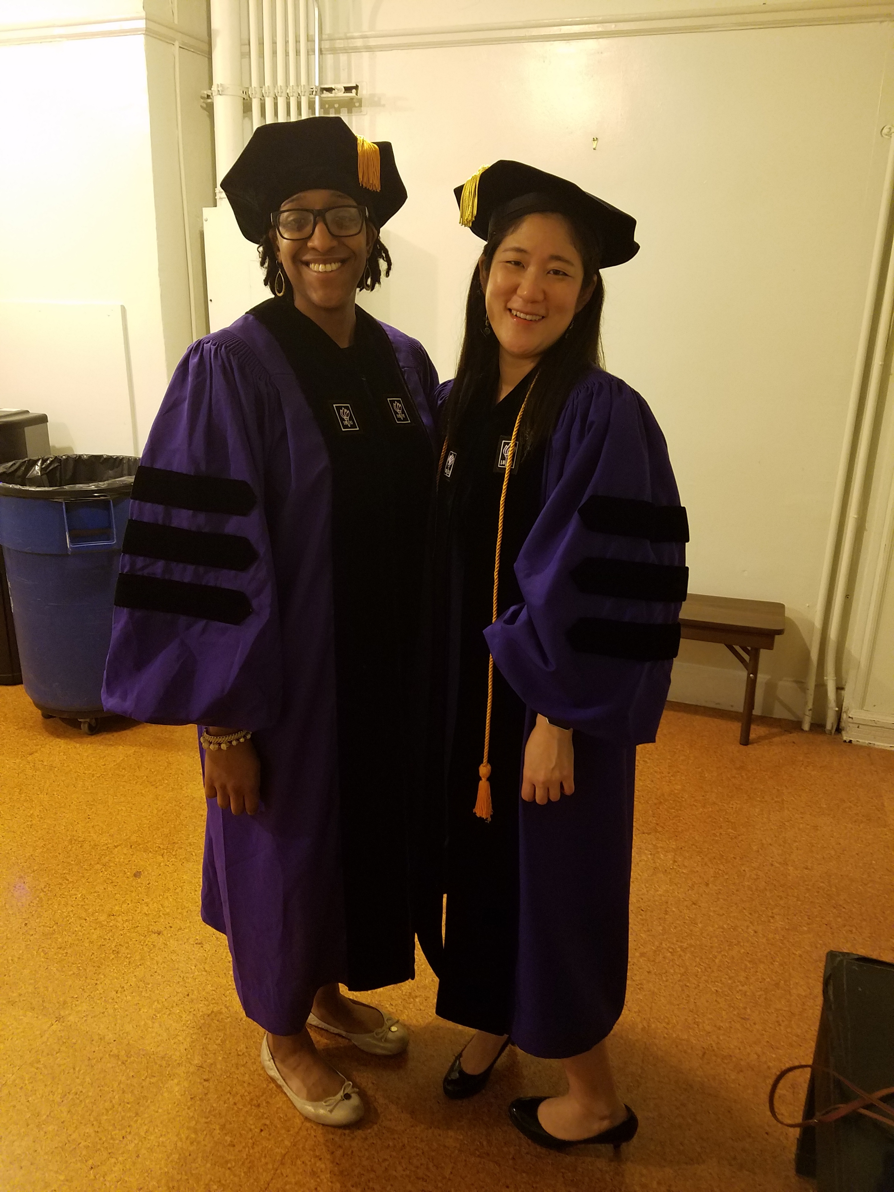 PhD graduates Jin Jun Melissa Ojemeni at graduation