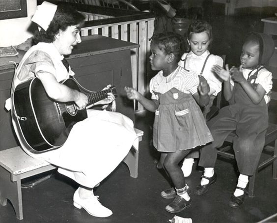 Nurse playing guitar of pediatric patients