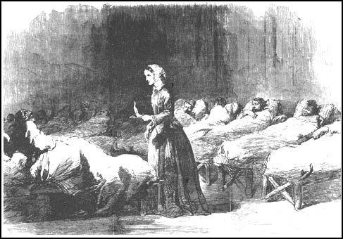 drawing of old time nurse in hospital tending to paitents